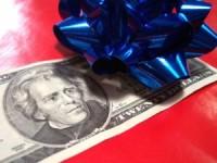 """alt=""""twenty dollar bill with blue bow"""""""